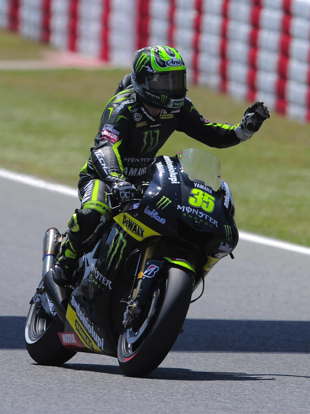 Monster Yamaha Tech 3's British Cal Crutchlow celebrates after placing third during the MotoGP qualifying session of the Catalunya Moto GP Grand Prix at the Catalunya racetrack in Montmelo, near Barcelona, on June 2, 2012. AFP PHOTO / JOSEP LAGOJOSEP LAGO/AFP/GettyImages
