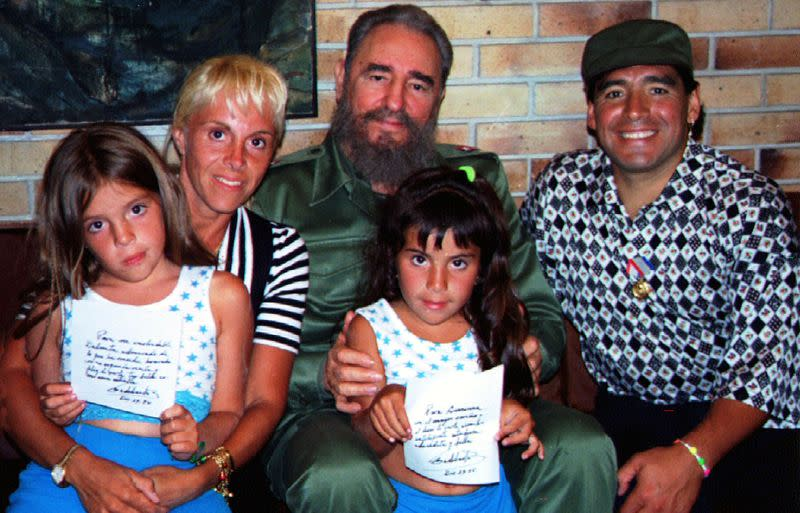 FILE PHOTO: Cuban President Fidel Castro poses with Argentine soccer star Diego Maradona, his wife Claudia Villa..