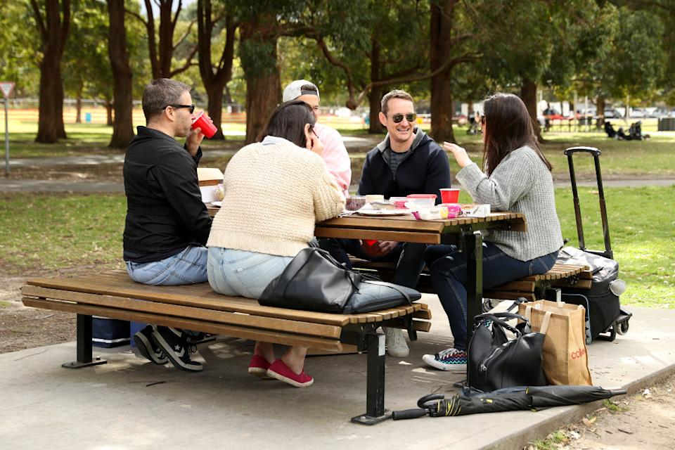 People gather to picnic at Centennial Park in Sydney, Australia.