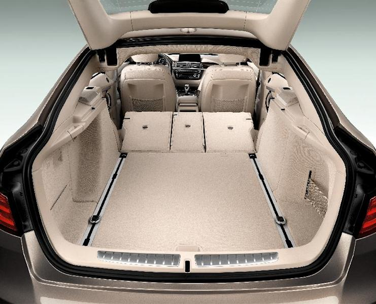This photo provided by BMW shows the interior of the new BMW 3 Series Gran Turismo, one of two important variations of its popular 3-Series small luxury sports sedans. On Wednesday, March 27, 2013, the German automaker will formally unveil the new 3 Series Gran Turismo, which has a bigger distance between the front and rear wheels to create more rear-seat legroom and cargo space in the trunk. The company also will unveil the 328d in the U.S., a 3-Series equipped with a diesel engine that could get more than 40 miles per gallon on the highway. (AP Photo/BMW)