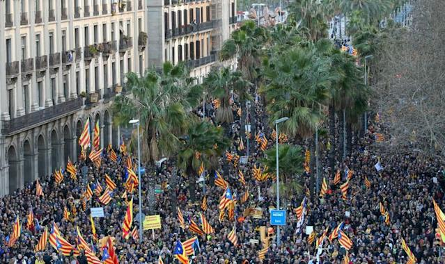 """People fly """"Esteladas"""" (Catalan separatist flag) during a demonstration held by pro-independence associations in Barcelona"""
