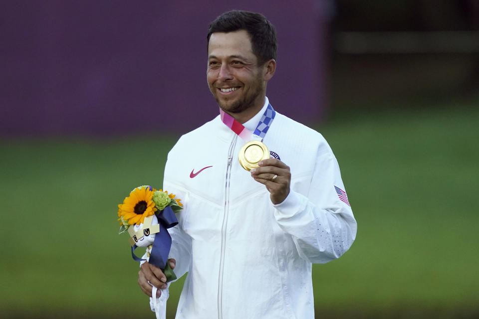 Xander Schauffele, of the United States, holds his gold medal after winning the men's golf event at the 2020 Summer Olympics, Sunday, Aug. 1, 2021, at the Kasumigaseki Country Club in Kawagoe, Japan, (AP Photo/Matt York)