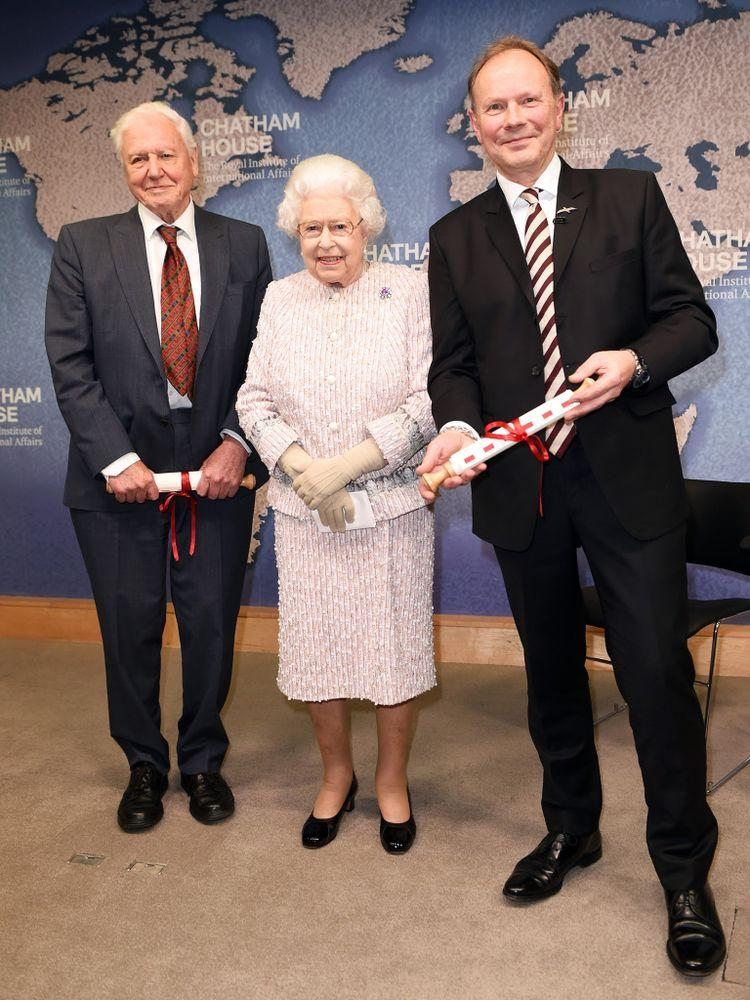 Queen Elizabeth presents the Chatham House Prize 2019 to Sir David Attenborough and Julian Hector | Eddie Mulholland - WPA Pool/Getty