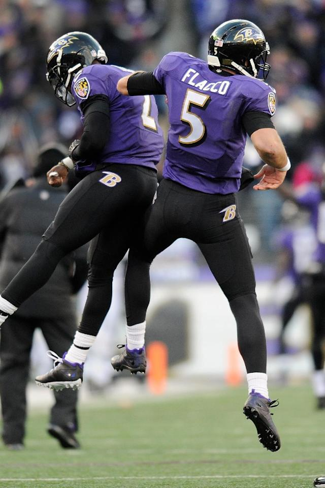 Baltimore Ravens quarterback Joe Flacco (5) celebrates his touchdown pass to wide receiver Jacoby Jones with teammate quarterback Tyrod Taylor (2) during the second half of an NFL football game against the New York Jets in Baltimore, Sunday, Nov. 24, 2013. (AP Photo/Nick Wass)