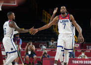 United States' Kevin Durant (7), right, and teammate Damian Lillard (6) celebrate during men's basketball preliminary round game against Iran at the 2020 Summer Olympics, Wednesday, July 28, 2021, in Saitama, Japan. (AP Photo/Charlie Neibergall)