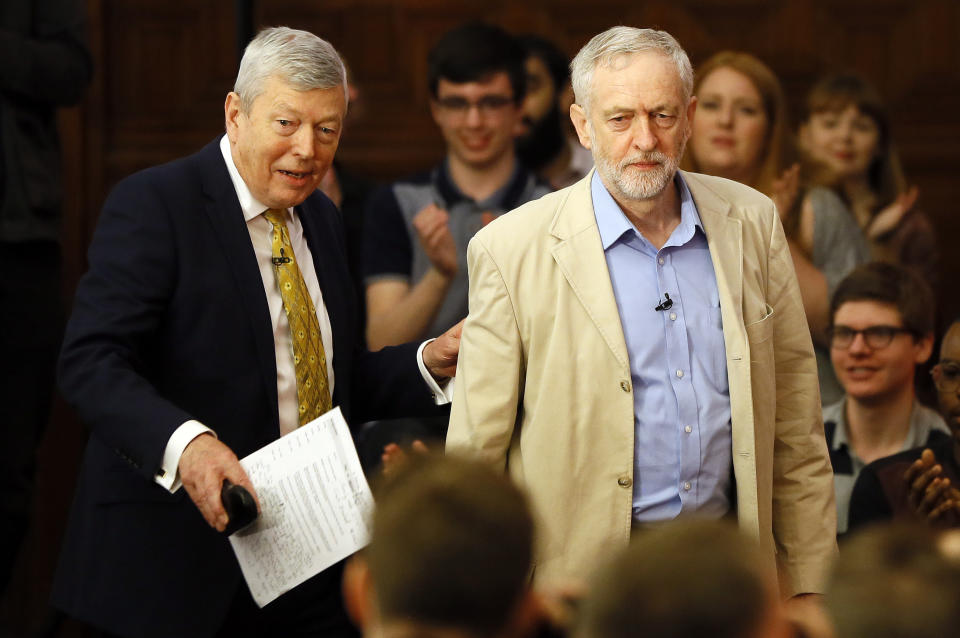 """Jeremy Corbyn, leader of Britain's Labour Party, right, arrives with and Labour MP Alan Johnson, left, to deliver a speech outlining Labour's position on the European referendum, in London, Thursday, April 14, 2016. Britain's opposition leader, Jeremy Corbyn, says Britain should stay in the European Union, arguing that """"a vote to remain in is in the best interests of the people of this country."""" Corbyn comes from the socialist left-wing of the Labour Party and has long been seen as a lukewarm supporter of the 28-nation bloc. In 1975, he voted against joining what was then the European Economic Community.  (AP Photo/Kirsty Wigglesworth)"""