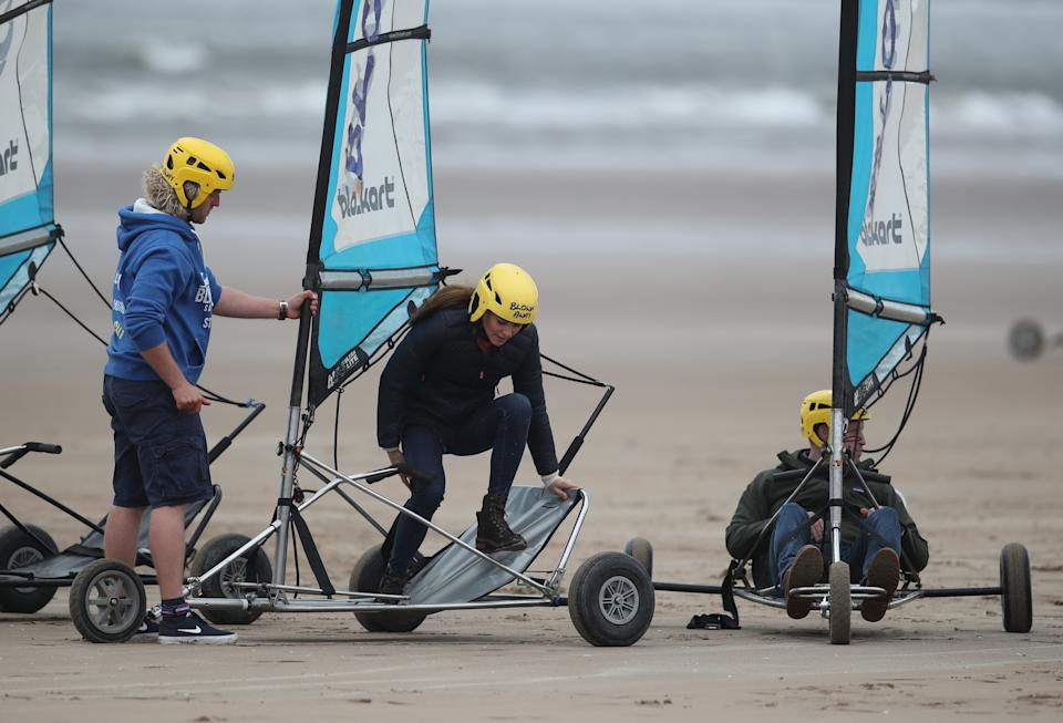 EMBARGOED UNTIL 1050 WEDNESDAY MAY 26 The Duke and Duchess of Cambridge with a group of young carers land yachting on the beach at St Andrews. Picture date: Wednesday May 26, 2021.