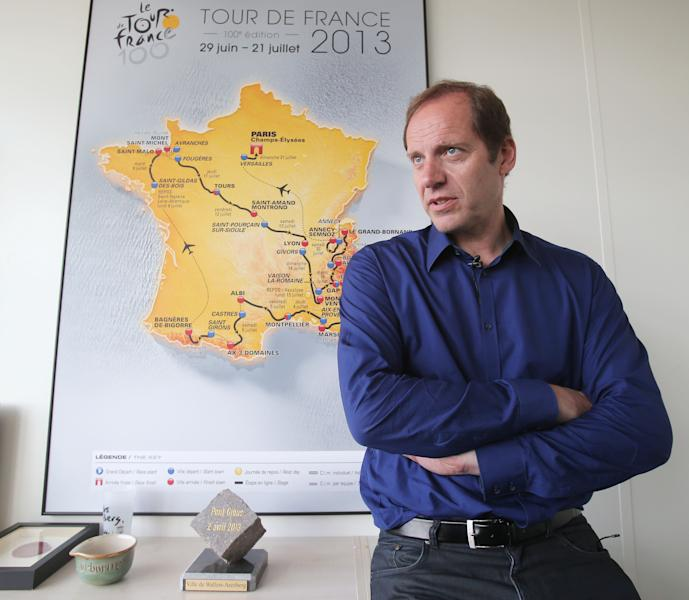 Tour De France Director Christian Prudhomme speaks during an interview with the Associated Press in Issy les Moulineaux outside Paris, Tuesday, June 18, 2013. The road map of the 100th edition of the Tour de France 2013 is in the background. The Tour de France starts June 29 on the French Mediterranean island of Corsica. (AP Photo/Michel Euler)