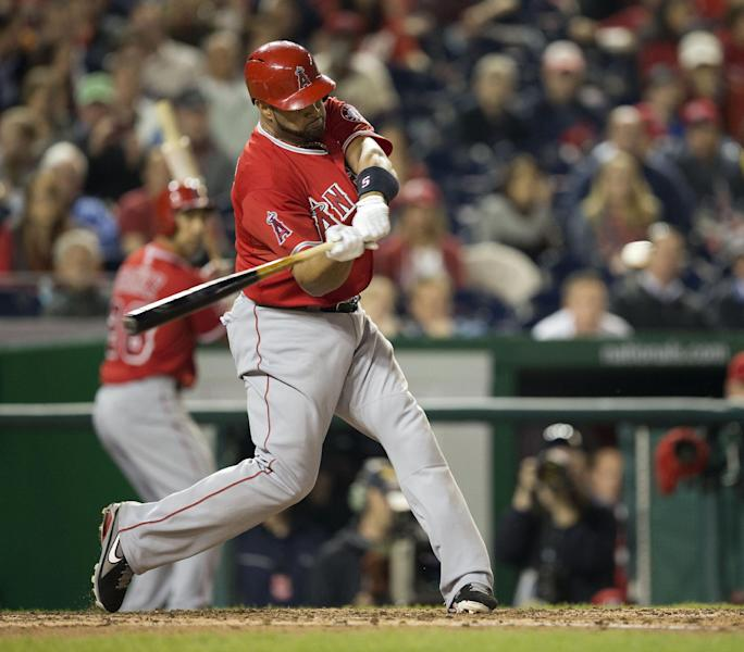 Los Angeles Angels Albert Pujols connects for a two-run homer against Washington Nationals Taylor Jordan in the fifth inning of a baseball game in Washington, Tuesday, April 22, 2014. This was Pujols 500th career home run. (AP Photo/Pablo Martinez Monsivais)