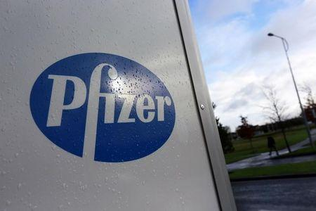 A company logo is seen at a Pfizer office in Dublin