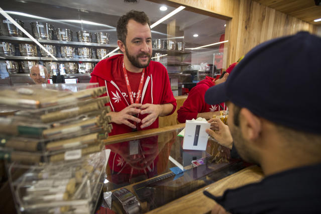 <p>A customer buys cannabis products at MedMen, one of the two Los Angeles area pot shops that began selling marijuana for recreational use under the new California marijuana law today, on Jan. 2, 2018 in West Hollywood, Calif. (Photo: David McNew/Getty Images) </p>