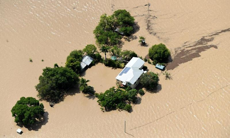 A property is surrounded by flood waters caused by Cyclone Debbie near Rockhampton .