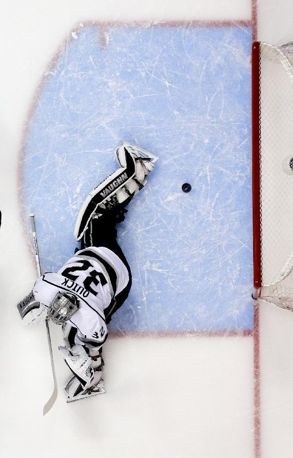 Los Angeles Kings goalie Jonathan Quick fails to stop a goal by Anaheim Ducks center Nick Bonino during the first period in Game 5 of an NHL hockey second-round Stanley Cup playoff series in Anaheim, Calif., Monday, May 12, 2014. (AP Photo/Chris Carlson)
