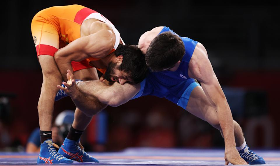 CHIBA, JAPAN - AUGUST 5, 2021: Indias Kumar Ravi (L) and ROC's Zaur Uguev fight in the men's freestyle 57kg final wrestling bout at the 2020 Summer Olympic Games, at the Makuhari Messe convention center. Stanislav Krasilnikov/TASS (Photo by Stanislav Krasilnikov\TASS via Getty Images)