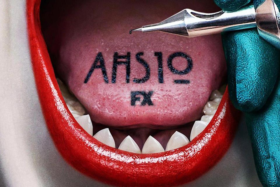 Poster for American Horror Story Season 10 shows the title tattooed on a tongue in a mouth full of pointy teeth.