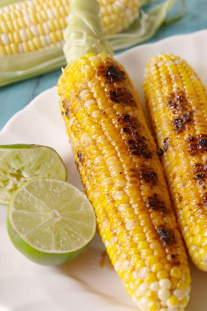 """<p>Our favorite way to eat grilled corn.</p><p>Get the recipe from <a href=""""https://www.delish.com/cooking/recipe-ideas/recipes/a48715/crack-corn-recipe/"""" rel=""""nofollow noopener"""" target=""""_blank"""" data-ylk=""""slk:Delish"""" class=""""link rapid-noclick-resp"""">Delish</a>.</p>"""