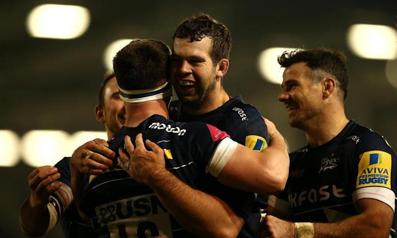 Ben Curry, left, celebrates his try with team-mates during the Premiership match between Sale Sharks and Worcester Warriors.