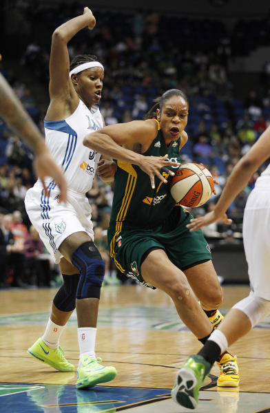 Seattle Storm forward Tina Thompson (7) pushes the ball down the court against Minnesota Lynx forward Rebekkah Brunson (32) in the opening game of a first-round WNBA basketball playoff series, Friday, Sept. 20, 2013, in Minneapolis. The Lynx won 80-64. (AP Photo/Stacy Bengs)