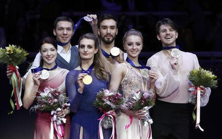 Figure Skating - ISU European Championships 2018 - Ice Dance Victory Ceremony - Moscow, Russia - January 20, 2018 - Gold medallists Gabriella Papadakis and Guillaume Cizeron of France (C), silver medallists Ekaterina Bobrova and Dmitri Soloviev of Russia (L) and bronze medallists Alexandra Stepanova and Ivan Bukin of Russia attend the ceremony. REUTERS/Grigory Dukor