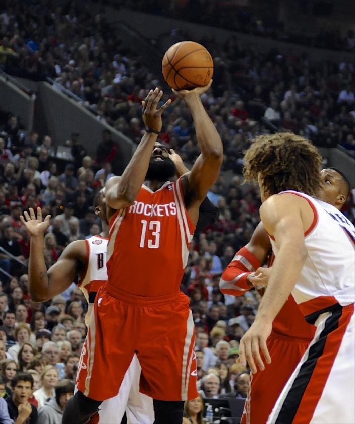 Houston Rockets' James Harden shoots against Portland Trail Blazers' Wesley Matthews, behind, during the first half of game six of an NBA basketball first-round playoff series game in Portland, Ore., Friday May 2, 2014. (AP Photo/Greg Wahl-Stephens)
