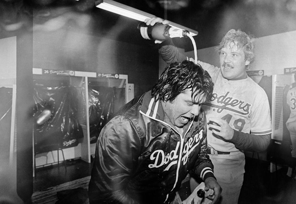 Dodgers pitcher Fernando Valenzuela is doused with champagne by teammate Tom Niedenfuer.