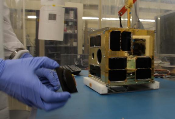 Cordell Grant putting the finishing touches to the first BRITE satellite at UTIAS-SFL
