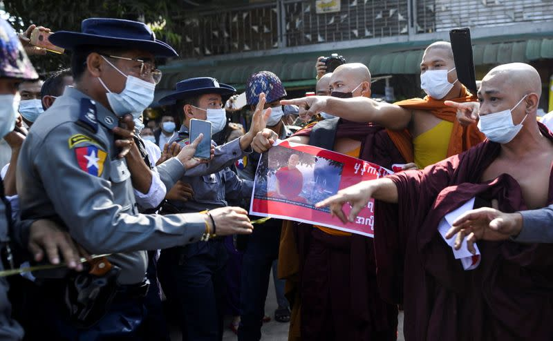 Police clash with Buddhist monks while they take part in a protest in support of the jailed nationalist right wing monk Wirathu outside Insein prison in Yangon