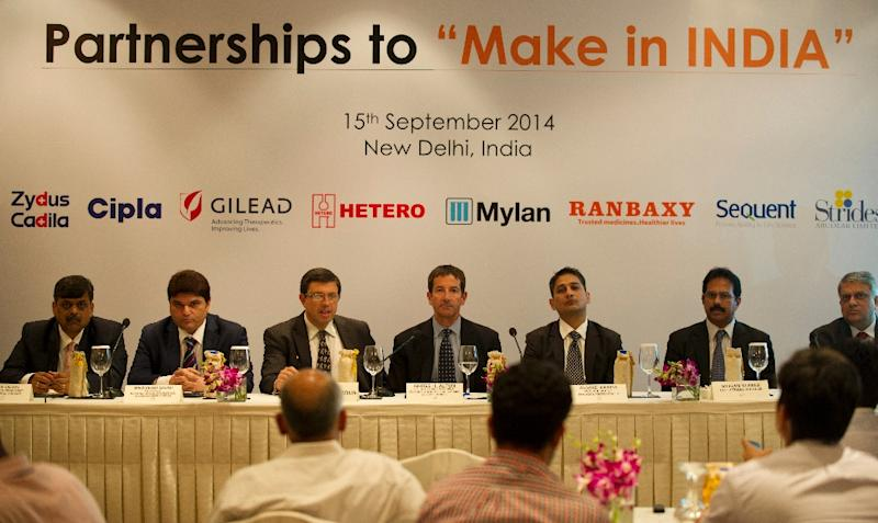 Gregg Alton (C) of Gilead Sciences looks on during a press conference in New Delhi on September 15, 2014, as Gilead Sciences announces it signed generic licensing deals with 7 India-based companies to increase access to its Hepatitis C drugs (AFP Photo/Sajjad Hussain)