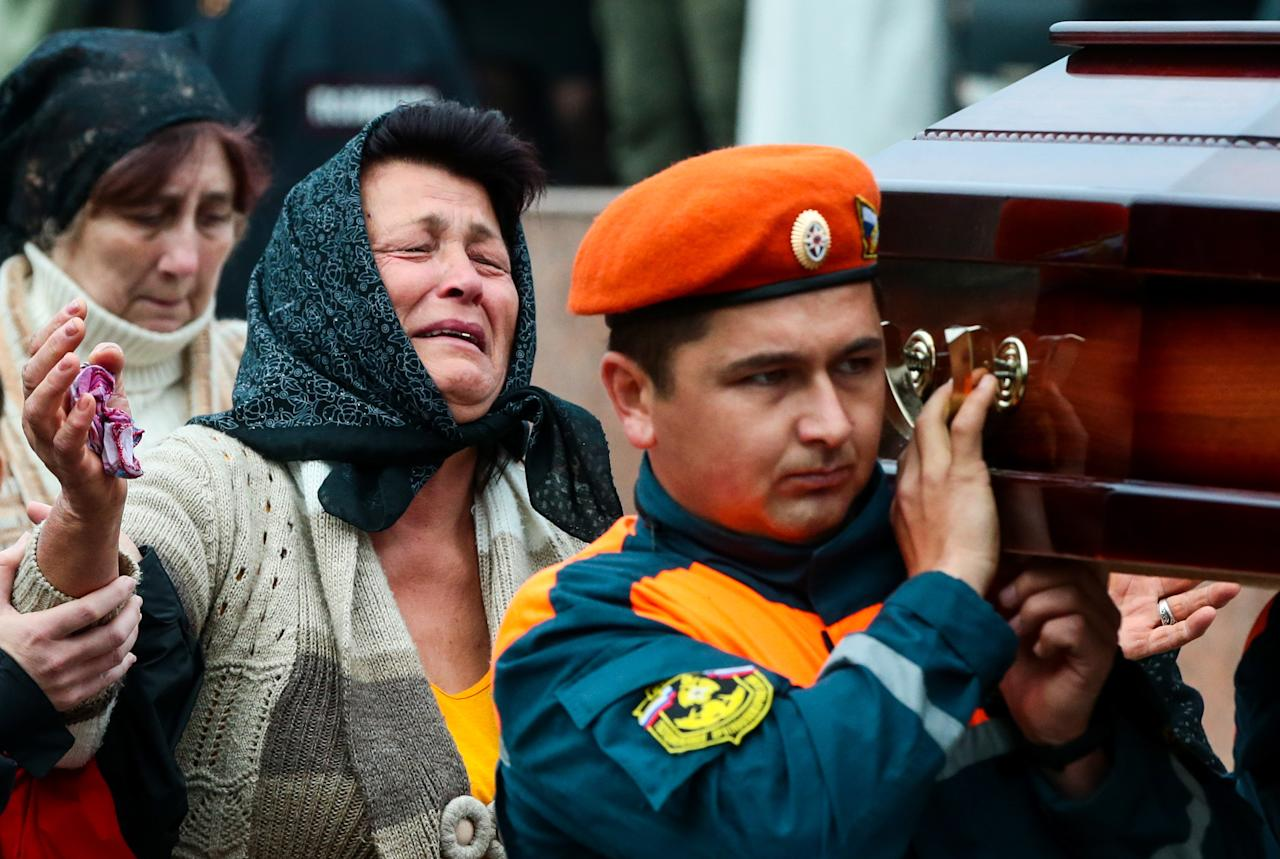 <p>Relatives of a Kerch school attack victim at a ceremony in Lenin Square on Oct. 19, 2018, to pay last respects to victims of the October 2018 explosion and shooting incident at the Kerch Polytechnic Vocational School in Kerch, Crimea. (Photo: Valery Matytsin/TASS via Getty Images) </p>