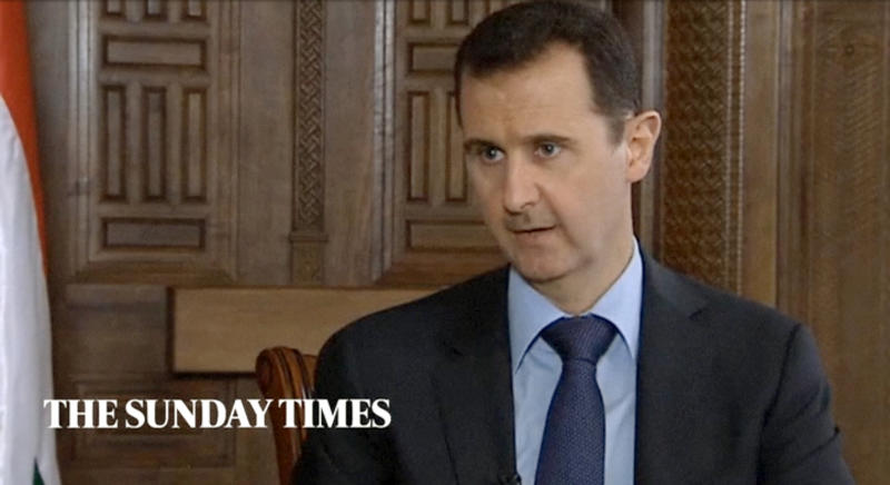 """In this image taken from video filmed on Thursday, Feb. 28, 2013 and released Saturday evening, March 2, 2013, Syrian President Bashar Assad speaks during an interview with the Sunday Times, in Damascus, Syria. Iran and Syria condemned a U.S. plan to assist rebels fighting to topple Assad on Saturday and signaled the Syrian leader intends to stay in power at least until 2014 presidential elections. Assad told the Sunday Times in the interview timed to coincide with U.S. Secretary of State John Kerry's first foreign trip that """"the intelligence, communication and financial assistance being provided is very lethal."""" Kerry announced on Thursday that the Obama administration was giving an additional $60 million in assistance to Syria's political opposition and would, for the first time, provide non-lethal aid directly to the rebels. (AP Photo/Sunday Times via AP video) THIS IMAGE IS FOR USE FOR 24 HOUR NEWS ACCESS ONLY, SUNDAY TIMES LOGO MUST NOT BE OBSCURED, NO ARCHIVES, NO SALES /PLEASE CONTACT SUNDAY TIMES SYNDICATION DEPARTMENT BY EMAIL TO ENQUIRIES@NISYNDICATION.COM FOR QUESTIONS REGARDING USE OUTSIDE THE 24 HOUR NEWS ACCESS WINDOW"""