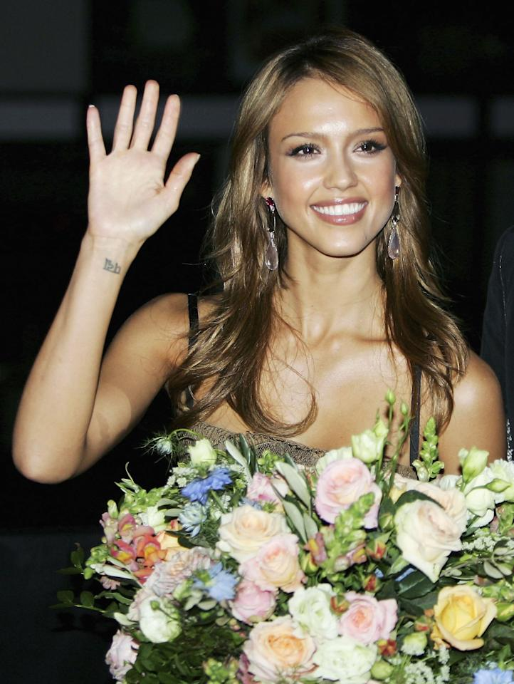 """<p>Alba got the word <a href=""""https://www.popsugar.com/latina/Does-Jessica-Alba-Have-Tattoos-42370629"""" class=""""ga-track"""" data-ga-category=""""Related"""" data-ga-label=""""https://www.popsugar.com/latina/Does-Jessica-Alba-Have-Tattoos-42370629"""" data-ga-action=""""In-Line Links"""">""""lotus"""" tattooed</a> on her wrist in Sanskrit. Alba explained on a Sept. 8 appearance of on <strong>The Late Show </strong> that she got the <a href=""""https://www.usmagazine.com/celebrity-body/news/jessica-alba-got-a-tattoo-after-splitting-from-a-famous-actor-w438879/"""" target=""""_blank"""" class=""""ga-track"""" data-ga-category=""""Related"""" data-ga-label=""""https://www.usmagazine.com/celebrity-body/news/jessica-alba-got-a-tattoo-after-splitting-from-a-famous-actor-w438879/"""" data-ga-action=""""In-Line Links"""">tattoo after a breakup</a>.</p>"""
