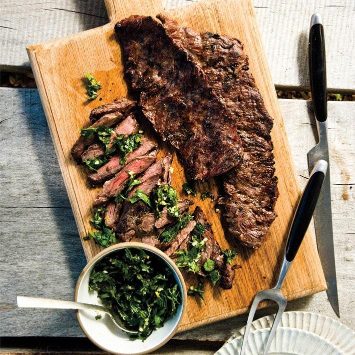 """Only spoon half of the salsa verde over the steak before serving—let everyone spoon the remainder over their serving themselves. <a href=""""https://www.epicurious.com/recipes/food/views/grilled-skirt-steak-with-herb-salsa-verde-395477?mbid=synd_yahoo_rss"""" rel=""""nofollow noopener"""" target=""""_blank"""" data-ylk=""""slk:See recipe."""" class=""""link rapid-noclick-resp"""">See recipe.</a>"""