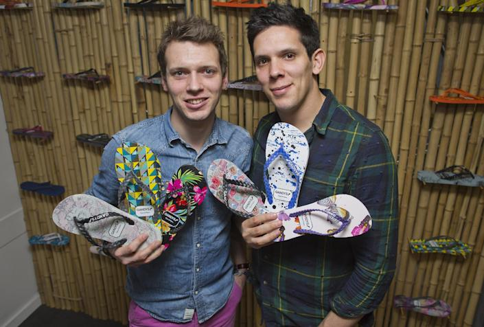 Paul (left) and Rob Forkan, founders of sandal-making firm Gandys, pose for pictures with their products in southwest London on December 17, 2014 (AFP Photo/Justin Tallis)