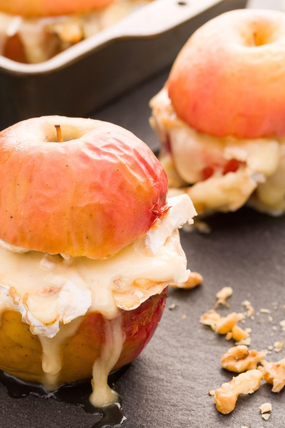 "<p>Take some of your favorite ingredients from a cheese plate—brie, honey, and apples—and turn them into a baked snack or dessert.</p><p>Get the recipe from <a href=""https://www.delish.com/cooking/recipe-ideas/recipes/a43871/baked-apple-with-brie-and-honey-recipe/"" rel=""nofollow noopener"" target=""_blank"" data-ylk=""slk:Delish"" class=""link rapid-noclick-resp"">Delish</a>.</p>"