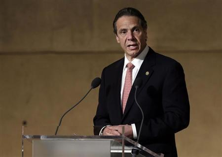 New York Governor Andrew Cuomo speaks during the dedication ceremony in Foundation Hall, of the National September 11 Memorial Museum, in New York