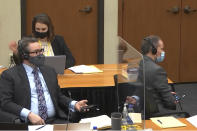 In this image from video, defense attorney Eric Nelson, left, Nelson's assistant Amy Voss, back, and former Minneapolis police officer Derek Chauvin, right, participate in a sidebar through headsets with Hennepin County Judge Peter Cahill as he presides Monday, March 29, 2021, in the trial of Chauvin, in the May 25, 2020, death of George Floyd at the Hennepin County Courthouse in Minneapolis, Minn. (Court TV via AP, Pool)