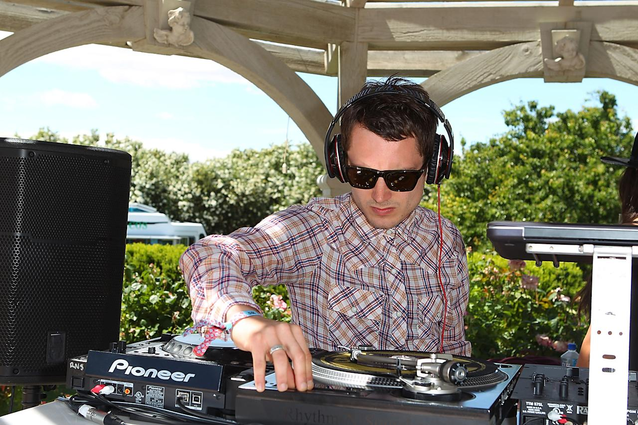 Elijah Wood spins music at the Lacoste pool party during the Coachella Music Festival in Thermal, California.