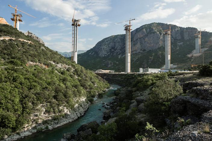 Cement pillars above Moraca river canyon are seen at a bridge construction site of the Bar-Boljare highway in Bioce, Montenegro in 2018. (Photo credit: REUTERS/Stevo Vasiljevic)