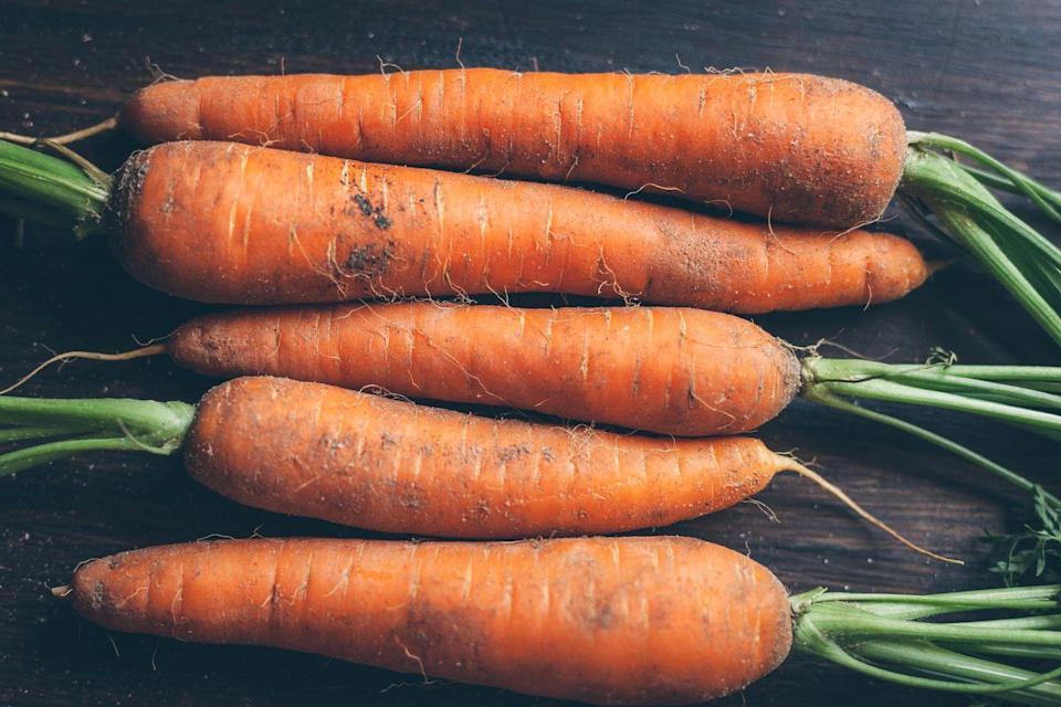 """<p>One of the UK's favourite vegetables, growing your own carrots will save you plenty of money in the long-run. While these generally take slightly longer to grow than others, you can still expect sweet, crunchy crops in just six weeks.</p><p>Chris says: """"Sow into pots of potting soil, spreading the seed thinly over the surface, then cover with a thin sieved layer of compost"""".</p><p><strong>Sowing to harvest: 50 days </strong></p><p><strong><a class=""""link rapid-noclick-resp"""" href=""""https://go.redirectingat.com?id=127X1599956&url=https%3A%2F%2Fwww.thompson-morgan.com%2Fp%2Fcarrot-nandor-f1-hybrid-kew-collection-seeds%2F4877TM&sref=https%3A%2F%2Fwww.prima.co.uk%2Fhome-ideas%2Fgardening%2Fg35861874%2Feasy-vegetables-to-grow-quickly-1%2F"""" rel=""""nofollow noopener"""" target=""""_blank"""" data-ylk=""""slk:BUY CARROT SEEDS"""">BUY CARROT SEEDS</a><br></strong></p>"""