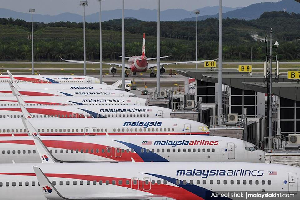 The tourism and airline industries were badly impacted. Malaysia Airlines planes are seen parked at Kuala Lumpur International Airport in Sepang, Selangor on Oct 18, 2020.