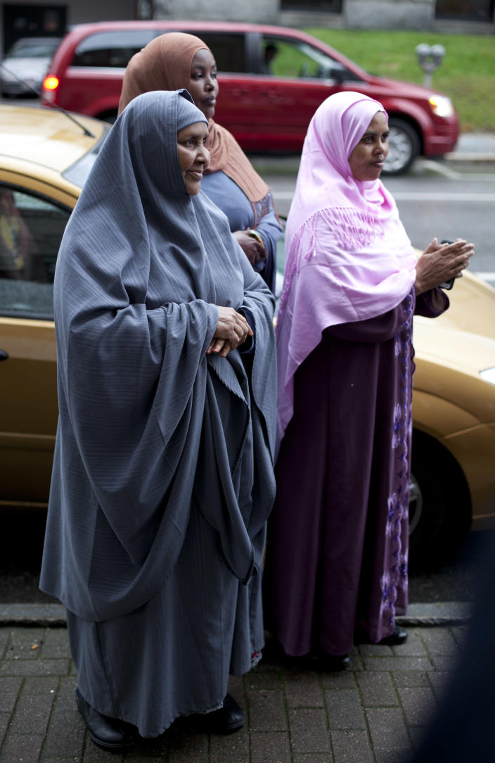 Somali women attend a protest outside city hall in Lewiston, Maine, after delivering petitions asking for the resignation of the city's mayor because of comments he made about Somali refugees,Thursday, Oct. 4, 2012. (AP Photo/Robert F. Bukaty)