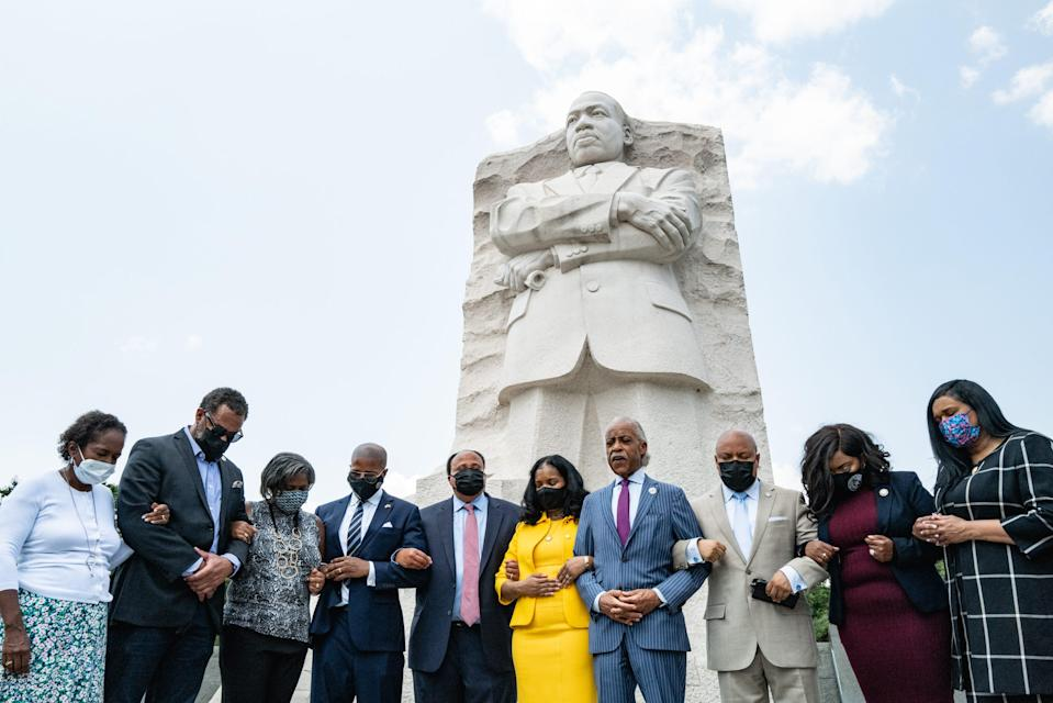 Martin Luther King III (in red tie), his wife, Arndrea Waters King, and the Rev. Al Sharpton at the Martin Luther King, Jr. Memorial on the National Mall on July 28, 2021.