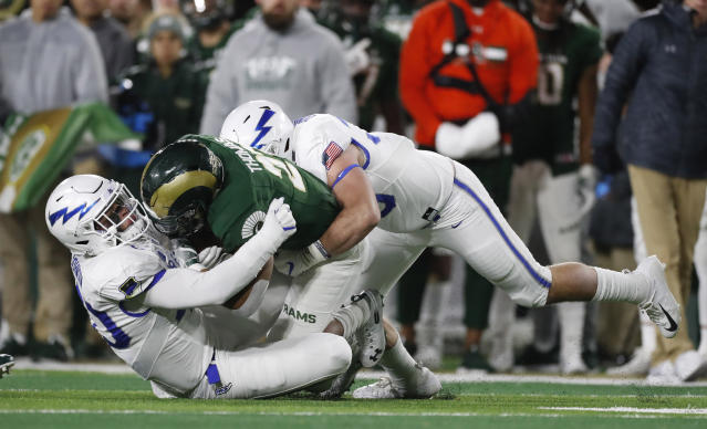 Colorado State running back Jaylen Thomas, center, is stopped after a short gain by Air Force linebackers Kyle Johnson, left, and Grant Donaldson in the first half of an NCAA football game Saturday, Nov. 16, 2019 in Fort Collins, Colo. (AP Photo/David Zalubowski)