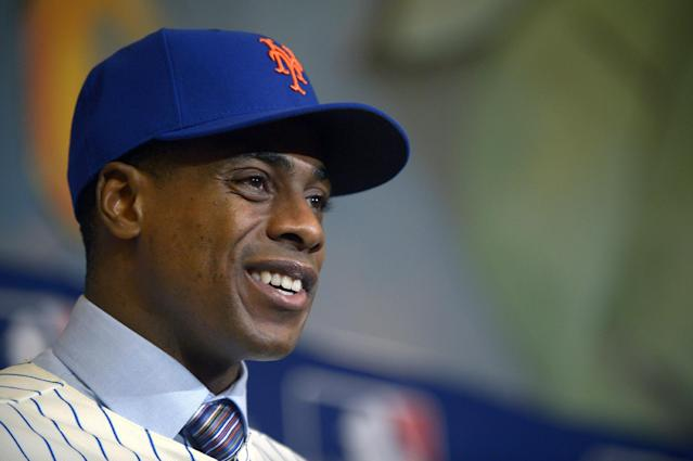 New York Mets newest outfielder Curtis Granderson answers a question during a news conference at baseball's winter meetings in Lake Buena Vista, Fla., Tuesday, Dec. 10, 2013.(AP Photo/Phelan M. Ebenhack)