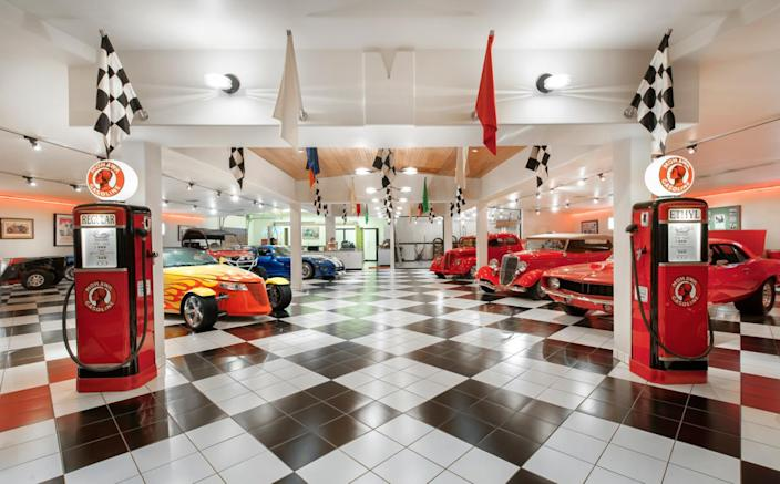 """<p>The 2,000-square-foot, 20-car showroom features a deionized-water car wash, power lifts for on-site vehicle maintenance, and two gas stations with diesel and unleaded fuel. (All photos via <a href=""""http://bit.ly/1OjQdjg"""" rel=""""nofollow noopener"""" target=""""_blank"""" data-ylk=""""slk:Concierge Auctions listing"""" class=""""link rapid-noclick-resp"""">Concierge Auctions listing</a>)</p>"""