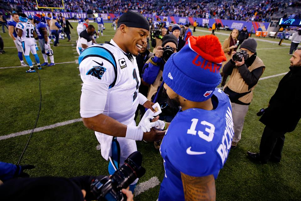 Cam Newton, left, and then-Giants receiver Odell Beckham, right, share a postgame handshake in 2015. (Photo by Michael Reaves/Getty Images)
