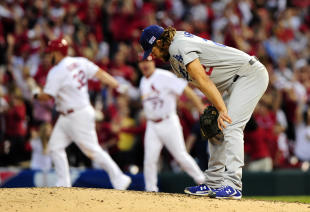 Clayton Kershaw (right) reacts after giving up the three-run home run to Matt Adams (USA Today).