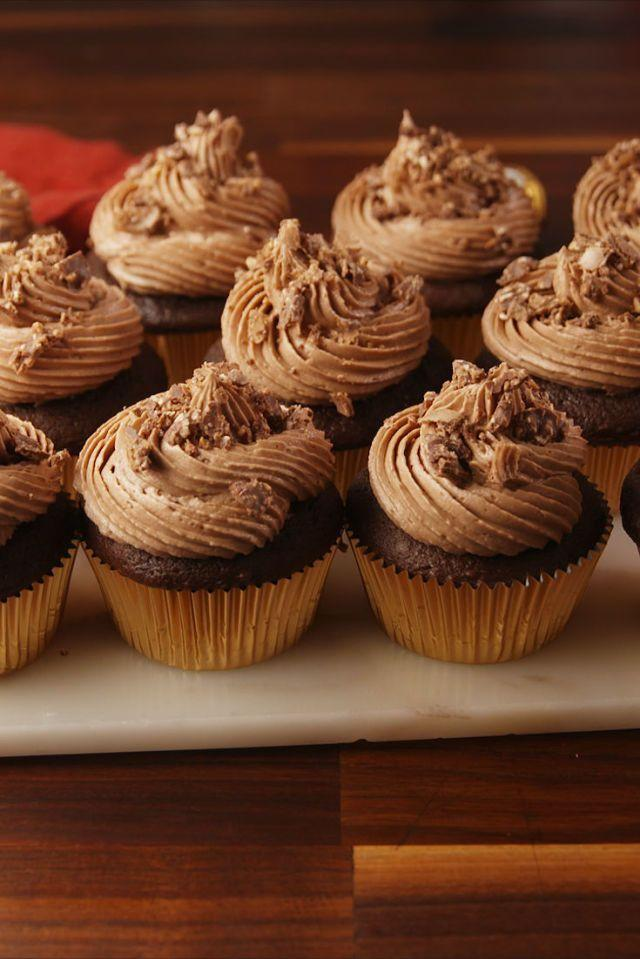 """<p>The most decadent cupcakes for hazelnut lovers.</p><p>Get the <a href=""""https://www.delish.com/uk/cooking/recipes/a28784289/ferrero-rocher-stuffed-cupcakes-recipe/"""" rel=""""nofollow noopener"""" target=""""_blank"""" data-ylk=""""slk:Ferrero Rocher Stuffed Cupcakes"""" class=""""link rapid-noclick-resp"""">Ferrero Rocher Stuffed Cupcakes</a> recipe.</p>"""