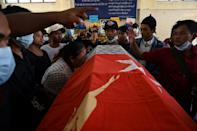 The mother (C) of teenage protester Aung Kaung Htet mourned his death beside his coffin