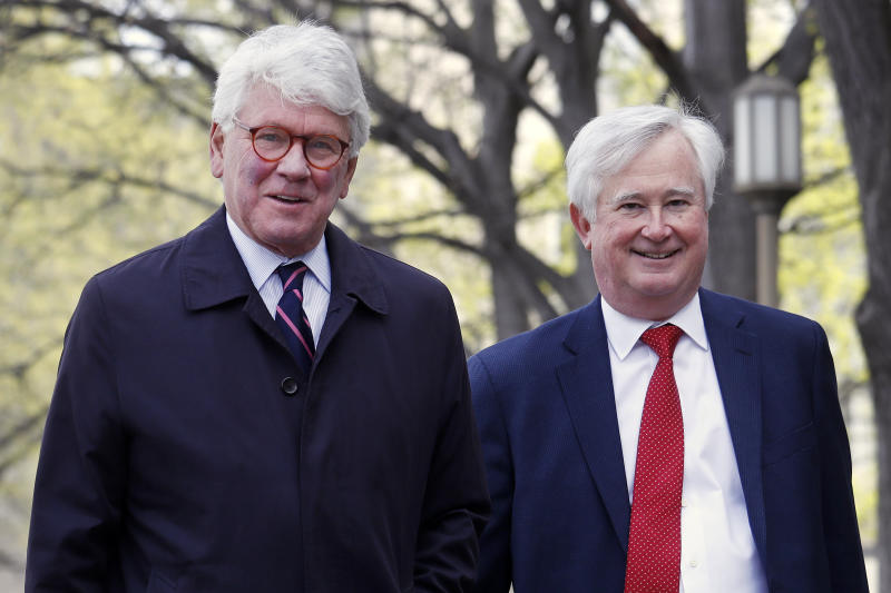 Greg Craig, left, arrives ahead of his arraignment at federal court in Washington on Friday April 12, 2019. (AP Photo/Jacquelyn Martin)